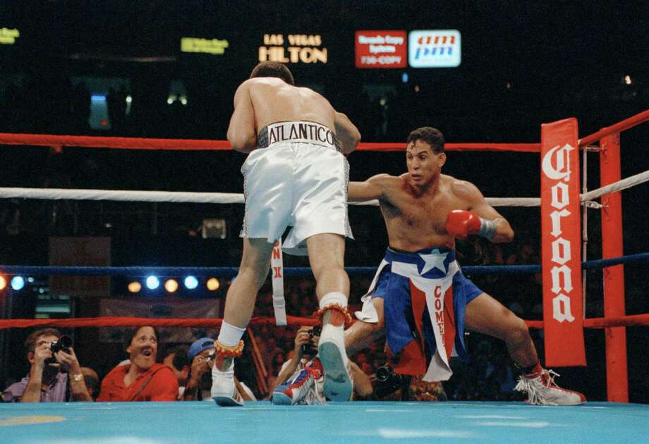 Challenger Hector Camacho gets down low in the corner while trying to avoid the relentless charge of champion and Mexican legend Julio Cesar Chavez during the third round of their WBC super lightweight title fight in Las Vegas, Nev., Sept 12, 1992. Chavez won a unanimous 12-round decision. Photo: Lenny Ignelzi, AP / AP