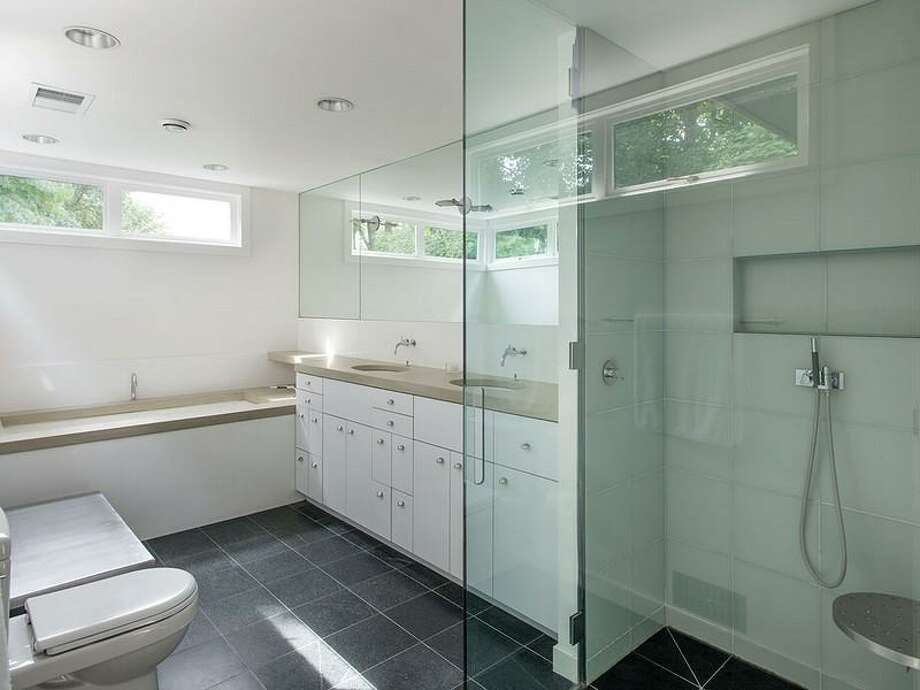 Bathroom of 1067 E Blaine St.. The 3,170-square-foot contemporary house has two bedrooms, 2.5 bathrooms, a double-height living and dining room, walls of glass, skylights, artisanal steel details, a unique, rolling desk, a deck and a pool on a 5,000-square-foot lot. It's listed for $2.175 million. Photo: Courtesy Moira Holley/Realogics Sotheby's International Realty