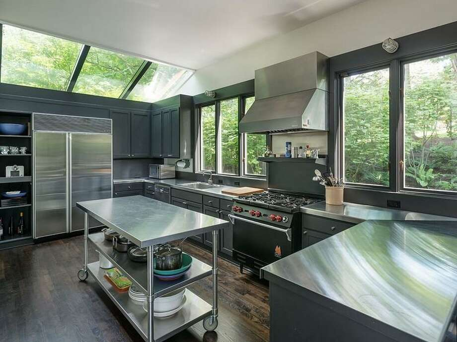 Kitchen of 1067 E Blaine St.. The 3,170-square-foot contemporary house has two bedrooms, 2.5 bathrooms, a double-height living and dining room, walls of glass, skylights, artisanal steel details, a unique, rolling desk, a deck and a pool on a 5,000-square-foot lot. It's listed for $2.175 million. Photo: Courtesy Moira Holley/Realogics Sotheby's International Realty
