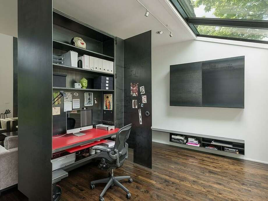 Rolling desk of 1067 E Blaine St.. The 3,170-square-foot contemporary house has two bedrooms, 2.5 bathrooms, a double-height living and dining room, walls of glass, skylights, artisanal steel details, a deck and a pool on a 5,000-square-foot lot. It's listed for $2.175 million. Photo: Courtesy Moira Holley/Realogics Sotheby's International Realty