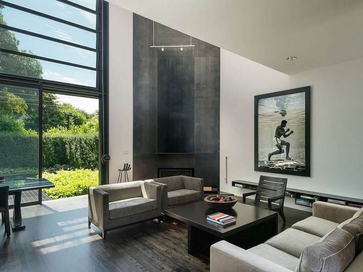 Living room of 1067 E Blaine St.. The 3,170-square-foot contemporary house has two bedrooms, 2.5 bathrooms, walls of glass, skylights, artisanal steel details, a unique, rolling desk, a deck and a pool on a 5,000-square-foot lot. It's listed for $2.175 million.