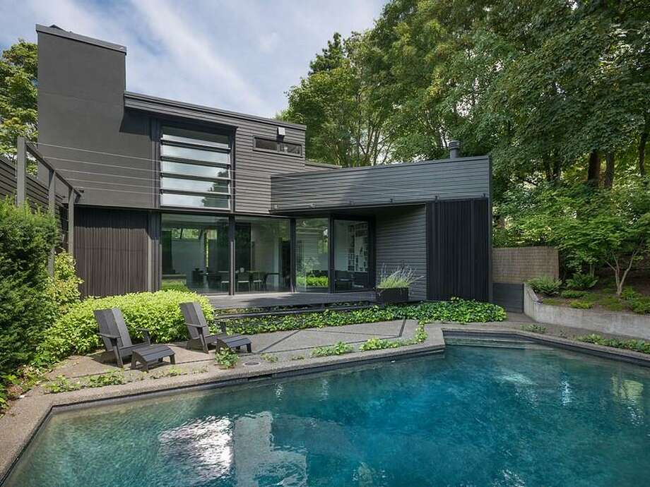 This Capitol Hill contemporary home, 1067 E Blaine St., was built in 1975 but recently overhauled by acclaimed Seattle architect Tom Kundig. The house is 3,170 square feet, with two bedrooms, 2.5 bathrooms, a double-height living and dining room, walls of glass, skylights, artisanal steel details, a unique, rolling desk, a deck and a pool on a 5,000-square-foot lot. It's listed for $2.175 million. Photo: Courtesy Moira Holley/Realogics Sotheby's International Realty