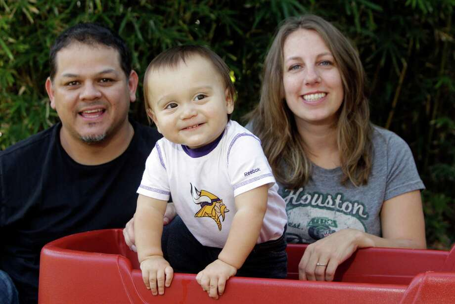 Art and Reesa Nevarez met while teaching at Hollibrook Elementary in Spring Branch, and at Thanksgiving last year were wondering if they'd ever get the call they were praying for. Marcus, almost 1, was their answer. Photo: Melissa Phillip, Staff / © 2012 Houston Chronicle
