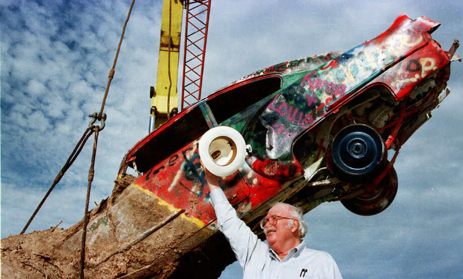 In this 1997 photo, Stanley Marsh 3 watches as workers lower into place one of the 10 cars that make up the Cadillac Ranch display. An attorney for Marsh said police searched his client's offices as part of a criminal probe. Photo: HENRY BARGAS, Associated Press / AMARILLO GLOBE NEWS/TIMES