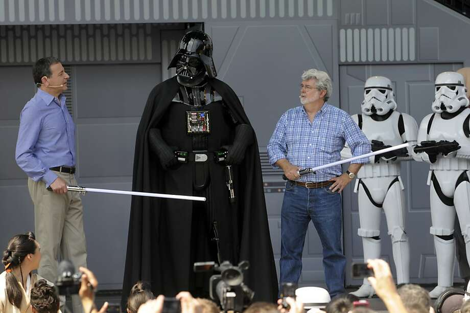 "George Lucas (right) and Disney CEO Robert Iger (left) will be wielding the light sabers on ""Episode VII"" and beyond. Photo: Phelan M. Ebenhack, Associated Press"