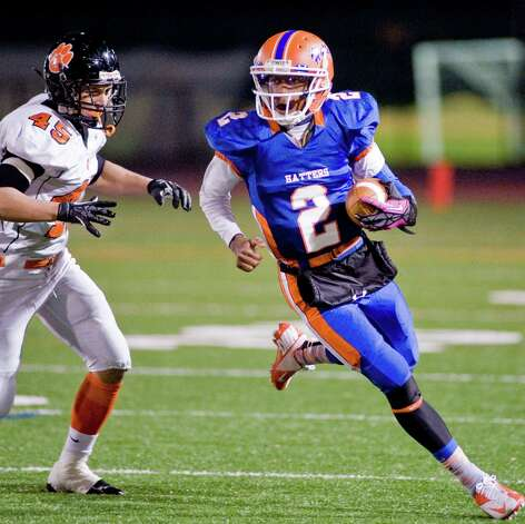 Ridgefield High School's Victor Fernandez tries to catch Danbury High School quarterback Elijah Duffy during a game at Danbury. Wednesday, Nov. 21, 2012 Photo: Scott Mullin / The News-Times Freelance