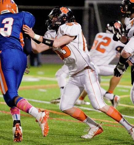 Ridgefield High School's Timothy Cozens blocks the Danbury High School defense in a game at Danbury. Wednesday, Nov. 21, 2012 Photo: Scott Mullin / The News-Times Freelance