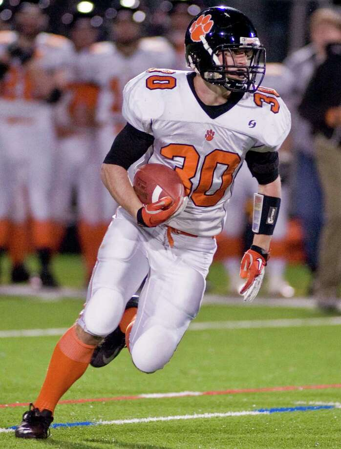 Ridgefield High School's Sam Gravitte reads the field as he carries the ball during a game against Danbury High School, played at Danbury. Wednesday, Nov. 21, 2012 Photo: Scott Mullin / The News-Times Freelance
