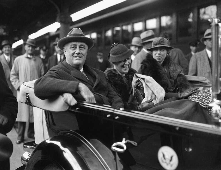 "President Franklin D. Roosevelt, his secretary Marguerite LeHand, and first lady Eleanor Roosevelt are shown at Union Station in Washington on their arrival from Warm Springs, Ga., Dec. 4, 1933.  The Roosevelts spent their Thanksgiving holiday in Georgia, at the ""Little White House.""  (AP) Photo: ASSOCIATED PRESS / AP1933"