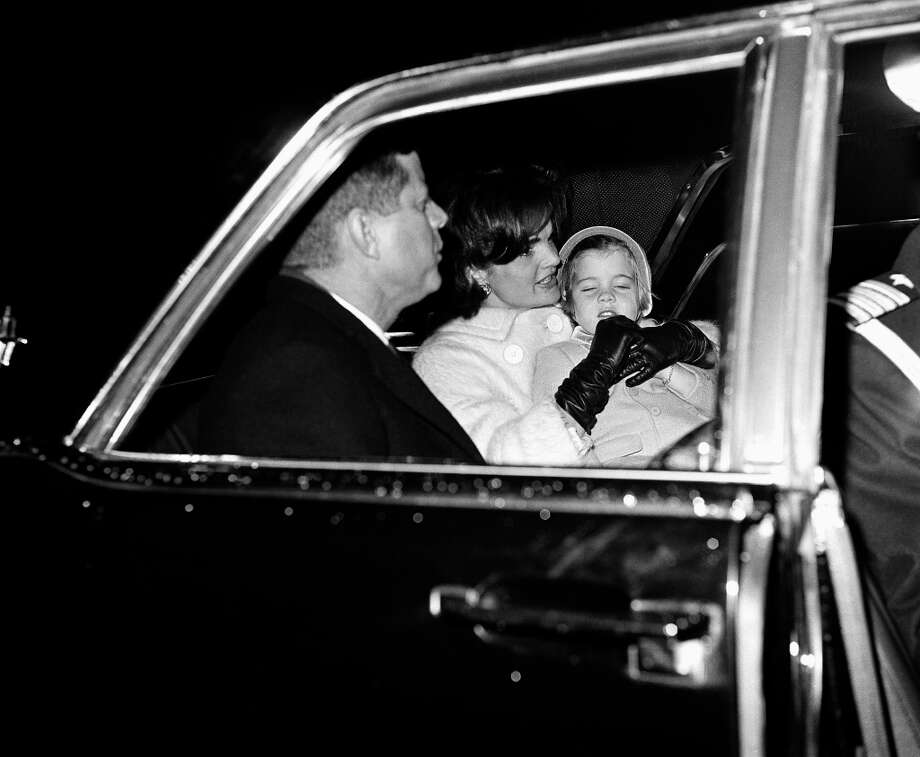 President Kennedy and his family leave Otis Air Force Base on Nov. 22, 1961, by auto for their nearby Hyannis Port home for a traditional Thanksgiving holiday with others of the Kennedy clan. Mrs. Kennedy holds daughter, Caroline, in her lap. John Jr., was left back at the White House in Washington because of a cold.  (Harvey Georges/AP) Photo: Harvey Georges, ASSOCIATED PRESS / AP1961