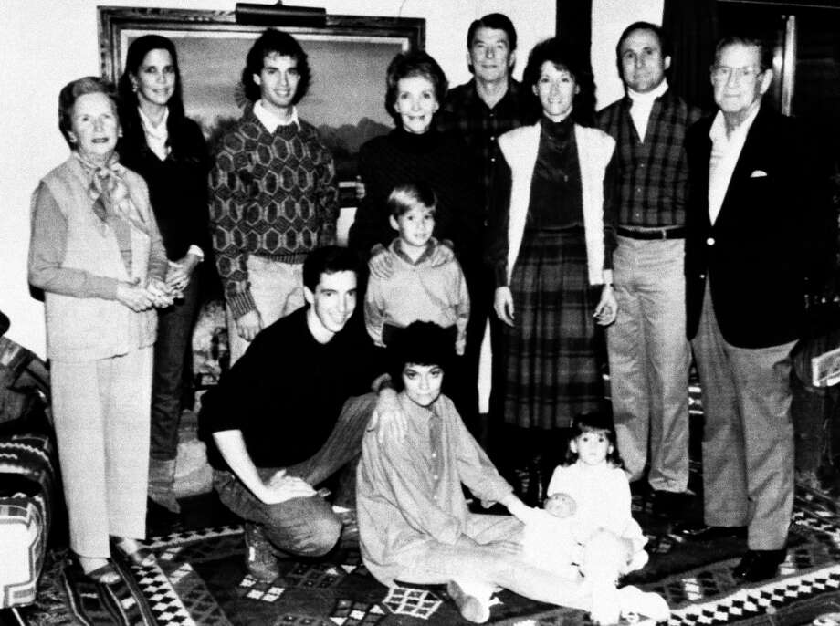 President and Mrs. Reagan pose with relatives  for a thanksgiving family portrait at Rancho del Cielo, at Santa Barbara, California  November 28, 1985.   Standing from left are: Bess Reagan;  Patti Davis; Paul Grilley; Nancy Reagan;  the president; Colleen and Michael Reagan; and Neil Reagan.  Foreground, left to right are: Ron and Doria Reagan; and Ashley Marie Reagan.   (Bill Fitz-Patrick/AP) Photo: Bill Fitz-Patrick, ASSOCIATED PRESS / AP1985