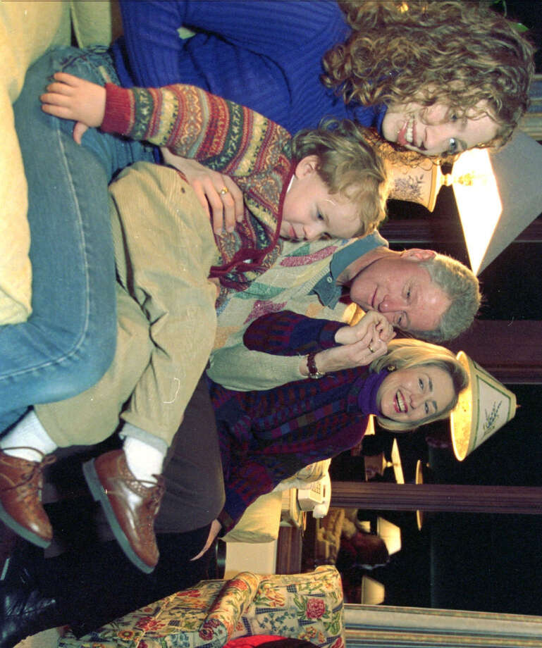 President Bill Clinton spends time with wife, Hillary, right, daughter Chelsea, left, and nephew Tyler Clinton, on Chelsea's lap, on Thanksgiving Thursday, Nov. 27, 1997, at Camp David near Thurmont, Md.  (Barbara Kinney/AP) Photo: BARBARA KINNEY, ASSOCIATED PRESS / AP1997