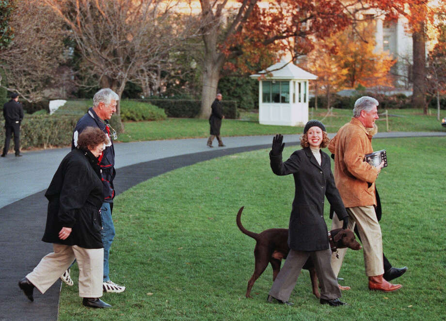 "US President Bill Clinton (R), with his wife Hillary (R, partly hidden), daughter Chelsea (C), his mother in law Dorothy Rodham (L), Clinton's step father Dick Kelly (back L) and family dog ""Buddy"" walk over the South Lawn of the White House as they leave for a weekend Thanksgiving retreat at Camp David, MD, 22 November, 2000. (Manny Ceneta/Getty) Photo: MANNY CENETA, AFP/Getty Images / AFP"