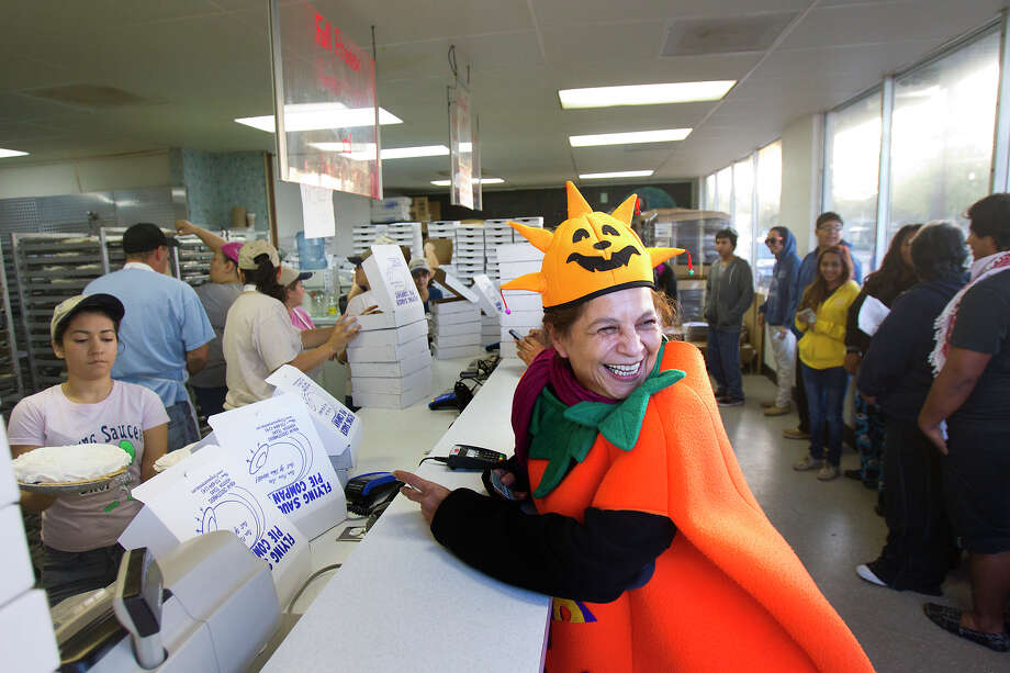 Belinda Escobar wears a pumpkin costume as she waits for her pies at Flying Saucer Pie Co., Wednesday, Nov. 21, 2012, in Houston. Escobar said she's buying seven pies and has been coming to the pie co., for 10 years. Photo: Cody Duty, Houston Chronicle / © 2012 Houston Chronicle