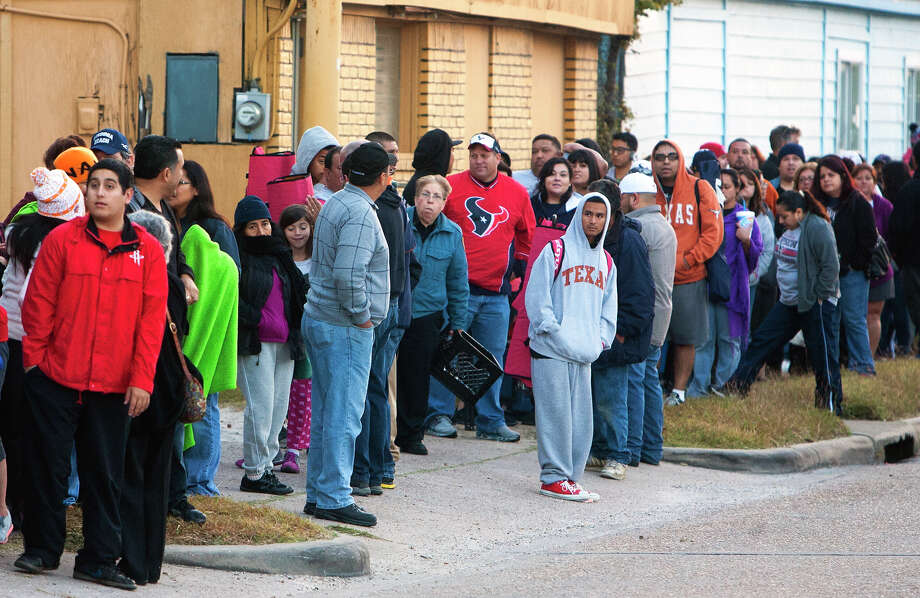 Customers wait in line for pies at Flying Saucer Pie Co., Wednesday, Nov. 21, 2012, in Houston. Photo: Cody Duty, Houston Chronicle / © 2012 Houston Chronicle
