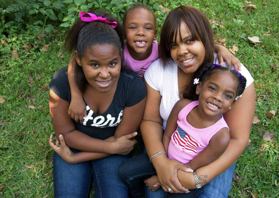 Crystal Everette, 32, hopes Goodfellows will make Christmas merrier for her  daughters  Emani, 12, left, Emori, 5, and Emaya, 3. Photo: J. Patric Schneider, Freelance / © 2012 Houston Chronicle