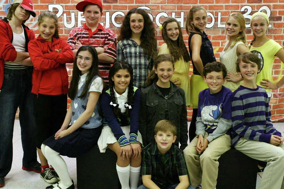 "Cast members from the anti-bullying musical, ""The New Kid,"" are shown here. Southbury actor Brandon Szep is the middle boy in the front row on the floor. Ridgefield actor Evan Smolin, also in the show, is second from right in the second row. Photo: Contributed Photo"