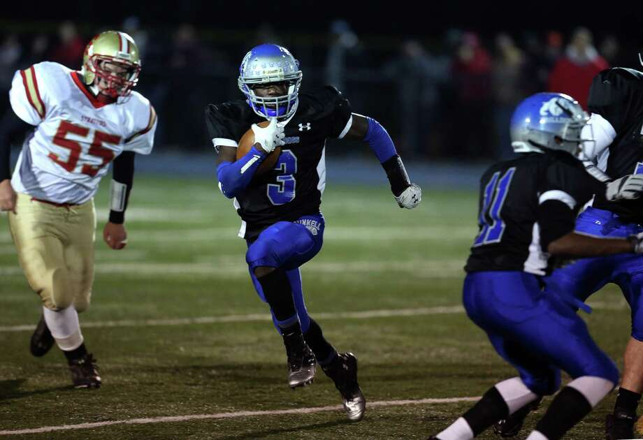 Mike Ross Connecticut Post freelance -Bunnell High School's #3 Terrence N'Dabian runs a long yardage first down during Wednesday evening match-up against Stratford High School. Photo: Mike Ross / Connecticut Post Freelance