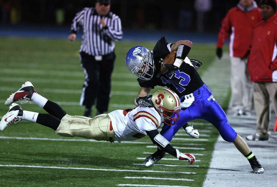 Mike Ross Connecticut Post freelance -Stratford High School's #20 Dana Smith dives and make the stop on Bunnell High School's #13 Andrew Calzone during first half action on Wednesday evening. Photo: Mike Ross / Connecticut Post Freelance