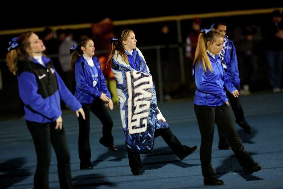 Mike Ross Connecticut Post freelance -Emily Butterworth, center of the Bunnell High School Junior Dance Team keeps warm while dancing with other team members during Wednesday evening game between Bunnell and Stratford High Schools. Photo: Mike Ross / Connecticut Post Freelance