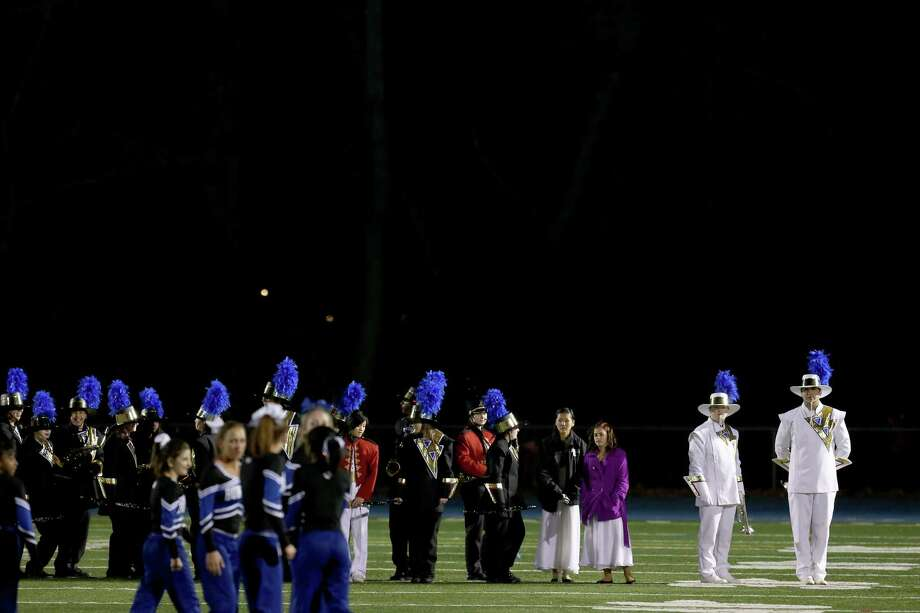 Mike Ross Connecticut Post freelance -Bunnell High School marching band wait their turn to take the field as Bunnell High School's Cheerleaders perform during half time show from Wednesday evening match up against Bunnell and Stratford High School's. Photo: Mike Ross / Connecticut Post Freelance