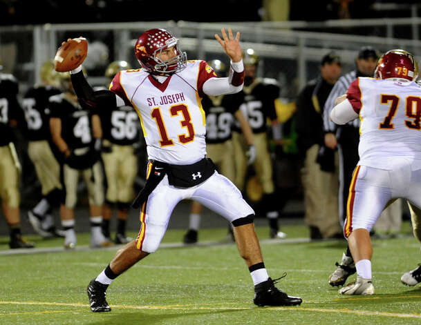 St. Joseph QB Jordan Vazzano passes the ball, during boys football action against Trumbull in Trumbull, Conn. on Wednesday November 21, 2012. Photo: Christian Abraham / Connecticut Post