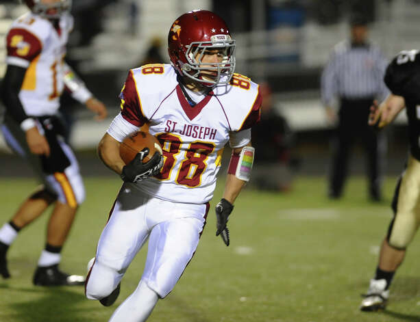 St. Joseph's #88 Shane Miller carries the ball, during boys football action against Trumbull in Trumbull, Conn. on Wednesday November 21, 2012. Photo: Christian Abraham / Connecticut Post