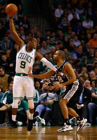 Rajon Rondo (left) of the Celtics handles the ball in front of Tony Parker of the Spurs on Nov. 21, 2012 at TD Garden in Boston (Jared Wickerham / Getty Images)