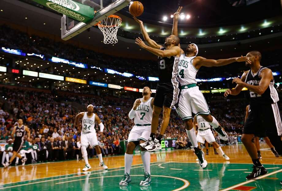 Tony Parker (9) of the Spurs drives to the basket for a layup in front of Chris Wilcox (44)  of the Celtics on Nov. 21, 2012 at TD Garden in Boston. (Jared Wickerham / Getty Images)