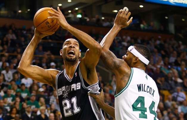 Tim Duncan (21) of the Spurs takes a shot in front of Chris Wilcox (44) of the Celtics on Nov. 21, 2012 at TD Garden in Boston. (Jared Wickerham / Getty Images)