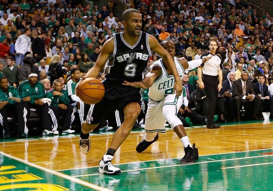 Tony Parker (left) of the Spurs drives under the basket past Rajon Rondo of the Celtics on Nov. 21, 2012 at TD Garden in Boston. (Jared Wickerham / Getty Images)