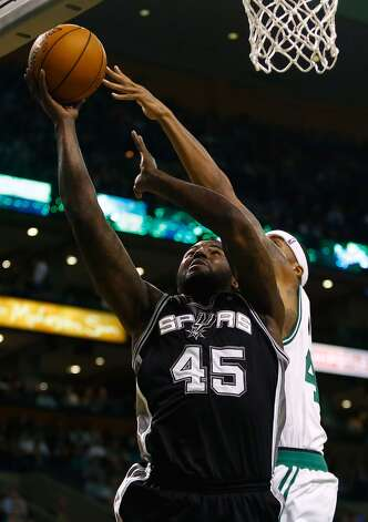 DeJuan Blair (45) of the Spurs goes up for a layup in front of Chris Wilcox (44) of the Celtics on Nov. 21, 2012 at TD Garden in Boston. (Jared Wickerham / Getty Images)