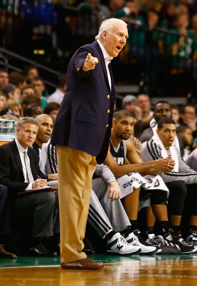 Spurs coach Gregg Popovich argues with a referee against the Celtics on Nov. 21, 2012 at TD Garden in Boston. (Jared Wickerham / Getty Images)