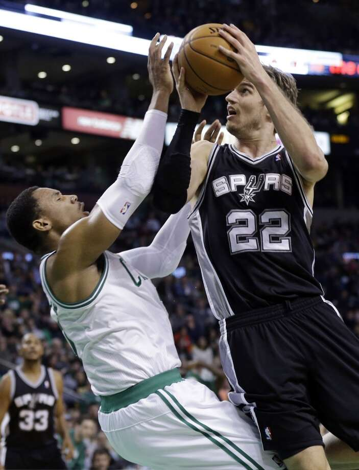 Spurs power forward Tiago Splitter (22) makes contact with Celtics forward Jared Sullinger (left) as he drives to the hoop during the first half in Boston, Wednesday, Nov. 21, 2012. Splitter was called for an offensive foul.  (Elise Amendola / Associated Press)