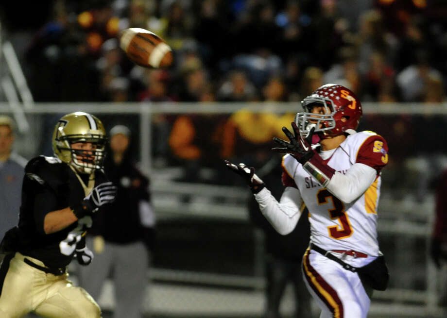 St. Joseph's #3 Jake Pelletier receives a pass which he then took to the endzone for a touchdown, during boys football action against Trumbull in Trumbull, Conn. on Wednesday November 21, 2012. Photo: Christian Abraham / Connecticut Post