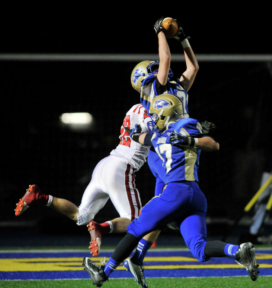 Newtown's Jack Kearney steals the ball from Masuk's Thomas Milone for an interception during their game at Newtown High School on Wednesday, Nov. 21, 2012. Newtown beat the undefeated Masuk, 21-14. Photo: Jason Rearick / The News-Times