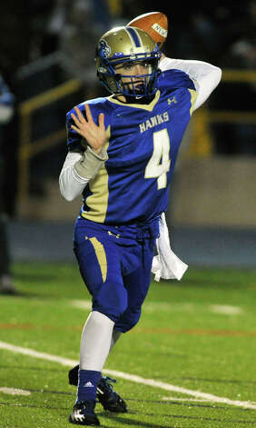 Newtown quarterback Andrew Tarantino throws the ball during their game against Masuk at Newtown High School on Wednesday, Nov. 21, 2012. Newtown beat the undefeated Masuk, 21-14. Photo: Jason Rearick / The News-Times