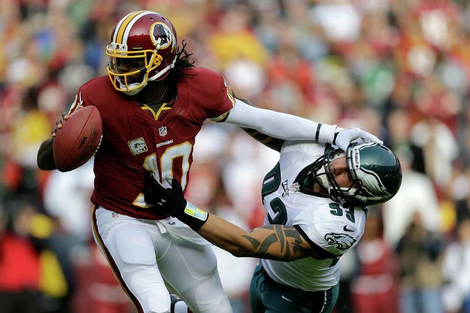 Robert Griffin III has been frustrating veteran NFL defenders like the Eagles' Jason Babin during his rookie season. Photo: Patrick Semansky, STF / AP