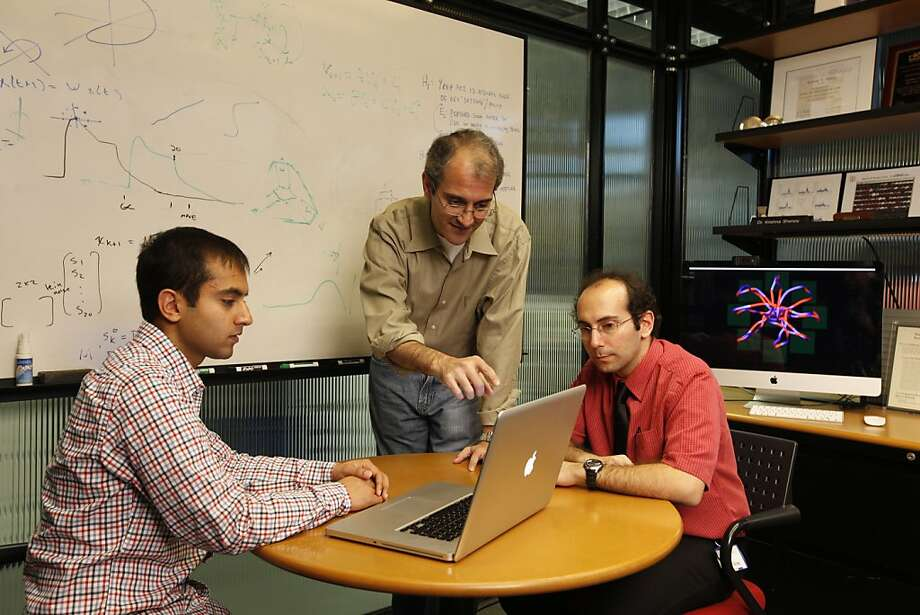 Stanford researchers Vikash Gilja (left), who developed the algorithm that allows the monkeys' thoughts to be translated, Krishna Shenoy and Paul Nuyujukian have been working on the project for years. Photo: Joel Simon, Stanford University