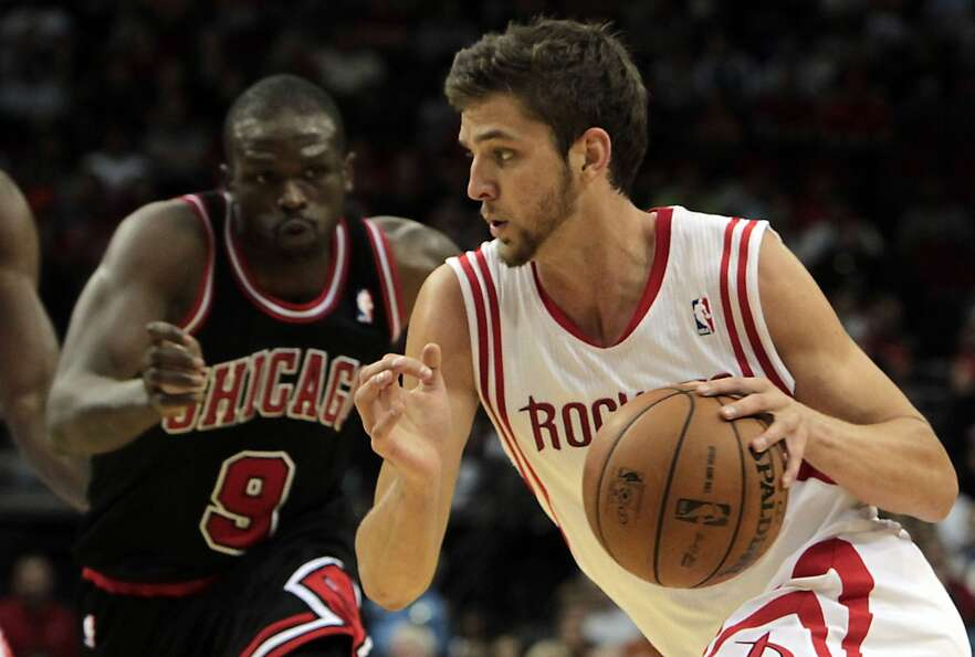 Rockets Chandler Parsons right, drives past the Bulls Luol Deng left, during the first quarter.