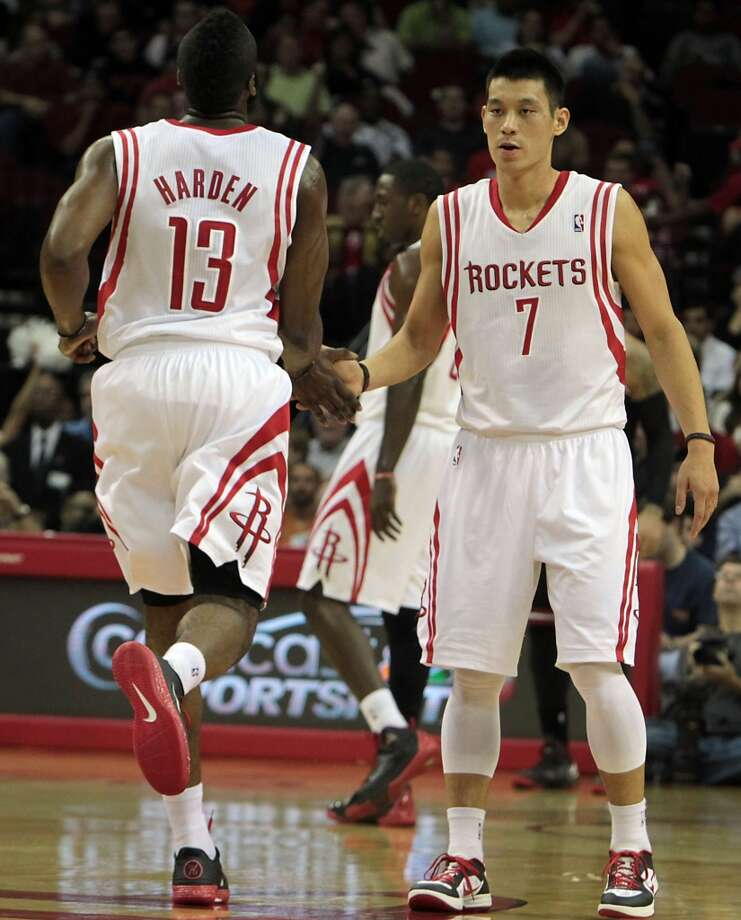 Rockets James Harden left, slaps hands with teammate Jeremy Lin, after Harden scored a basket against the Bulls during the first quarter. (James Nielsen / Houston Chronicle)