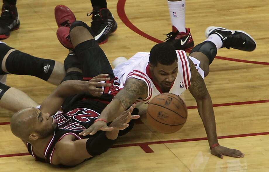 Taj Gibson left, and the Rockets Marcus Morris right, dive for a loose ball during the fourth quarter.( James Nielsen / Chronicle ) (James Nielsen / Houston Chronicle)