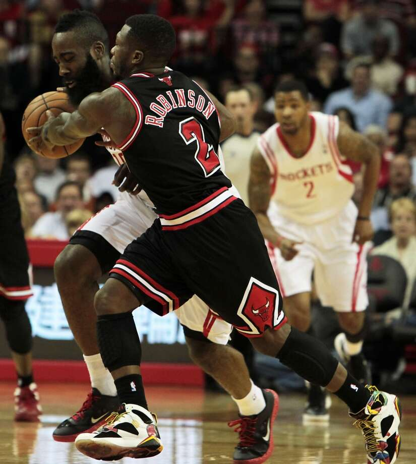 James Harden left, breaks away from the Bulls Nate Robinson during the second quarter.( James Nielsen / Chronicle ) (James Nielsen / Houston Chronicle)