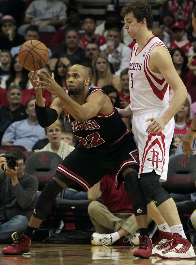 Taj Gibson left, and the Rockets Omer Asik right, during the second quarter. (James Nielsen  / Houston Chronicle)