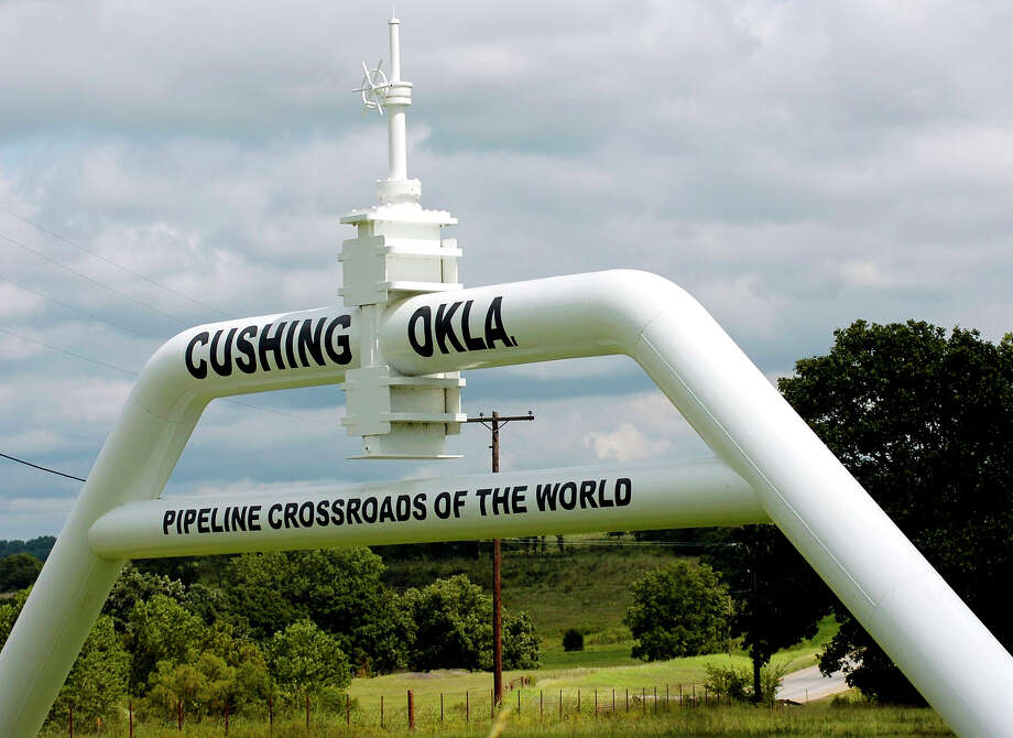 This sign welcomes travelers to Cushing, Okla. The Seaway Crude Oil Pipeline expansion could help ease the oil glut at Cushing, the main U.S. pipeline hub. Photo: Matt Strasen, MBR / The Oklahoman