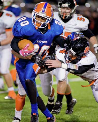 Danbury High School running back Akim Moffett escapes the tackle of Ridgefield High School's John Boscia during a game at Danbury. Wednesday, Nov. 21, 2012 Photo: Scott Mullin / The News-Times Freelance