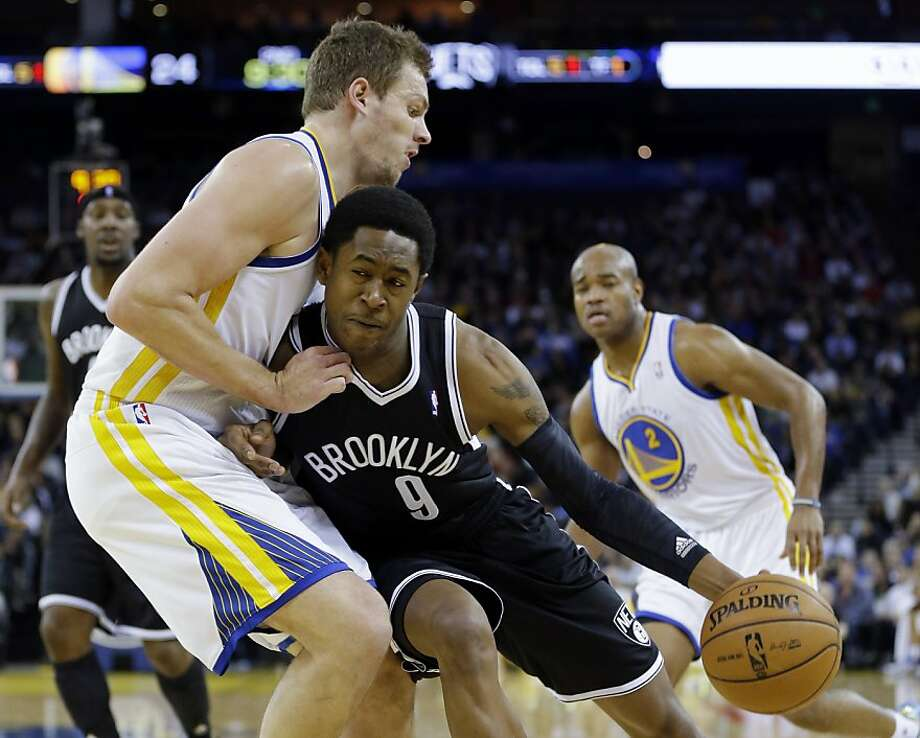 Golden State Warriors' David Lee, left, defends against Brooklyn Nets' MarShon Brooks (9) during the first half of an NBA basketball game in Oakland, Calif., Wednesday, Nov. 21, 2012. (AP Photo/Marcio Jose Sanchez) Photo: Marcio Jose Sanchez, Associated Press