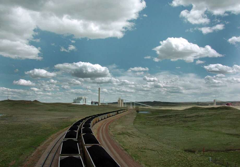 Coal trains idle near Dry Fork Station, a coal-fired power plant being built by the Basin Electric Power Cooperative near Gillette, Wyo. Photo: Matthew Brown, STF / AP2010