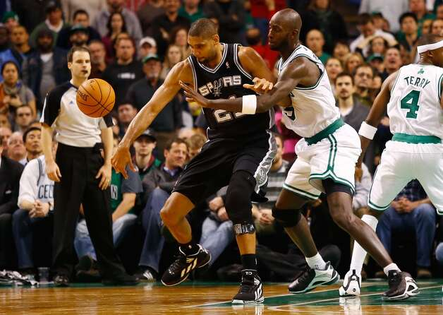 Kevin Garnett #5 of the Boston Celtics knocks the ball out of the hands of Tim Duncan #21 of the San Antonio Spurs on Nov. 21, 2012 at TD Garden in Boston. (Jared Wickerham / Getty Images)