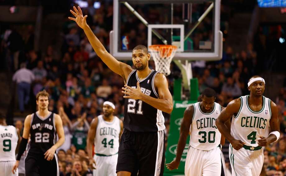 Tim Duncan #21 of the San Antonio Spurs signals to his teammates against the Boston Celtics on Nov. 21, 2012 at TD Garden in Boston. (Jared Wickerham / Getty Images)